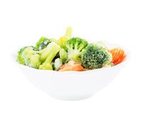Frozen vegetables in ceramic bowl isolated on white Royalty Free Stock Images