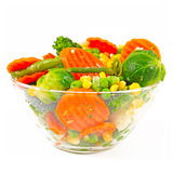 Frozen vegetables in a glass bow. L on a white background Stock Photos