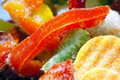 Frozen vegetables and ice. Good quality close up photo of frozen vegetables. There`re lots of chopped bulgarian peppers, carrots, beans and zucchinies on the Royalty Free Stock Photos