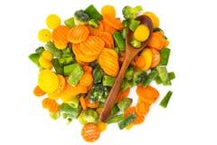 Frozen vegetables mix on a white background Stock Photos