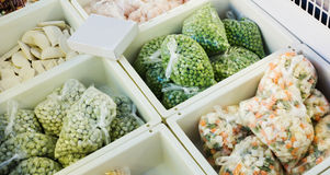 Frozen vegetables in refrigerator of supermarket Royalty Free Stock Photo