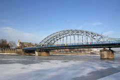 Frozen Vistula river and bridge in Krakow, Poland Stock Photo