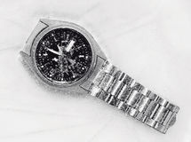 Frozen watch. Stop time concept through a frozen watch royalty free stock images