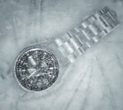 Frozen watch. Stop time concept through a frozen watch stock photos