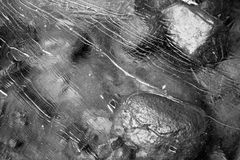 Frozen Water. Cracked ice pattern over a boulder in black and white Royalty Free Stock Photo