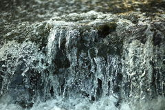 Frozen water. Stopped camera time (running water Stock Images