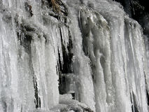 Frozen water. The icicles wall from frozen falling water due to extremely low temperatures in the mountains Stock Photo