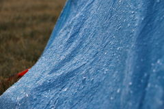 Frozen water drops on blue material. Frozen water drops on tent Royalty Free Stock Image