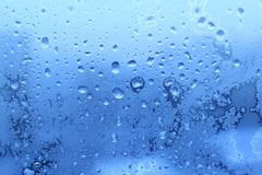 Frozen water drops on glass. Ice water drops on winter glass Royalty Free Stock Photos