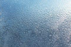 Frozen water drops on glass. Texture of frozen water drops on glass Royalty Free Stock Image