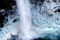 Frozen waterfall icicles. Snoqualmie Falls is a 268-foot waterfall in the northwest United States, located east of Seattle on the Snoqualmie River between royalty free stock photography