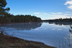 Frozen water in the forest. In the forests around Halden municipality are a number of water and lakes. In winter, the lakes are frozen. There are abundant royalty free stock photography