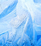 Frozen water on glass. Pattern of frozen water on a glass surface closeup Stock Image