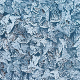 Frozen water on the glass surface. Royalty Free Stock Image