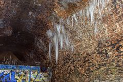 Frozen water icicles in the tunnel Stock Photos
