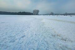 Frozen water reservoir on fields. Winter landscape. Beautiful winter landscape with ice structure. Frozen water reservoir on fields. ice structure stock photos
