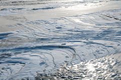 Frozen water of the sea in winter Stock Photos
