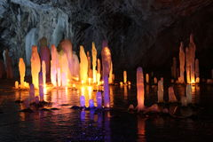 Frozen water Stalagmite in deep marble cave, Russia Stock Photos