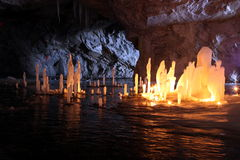 Frozen water Stalagmite in deep marble cave. Russia royalty free stock photo