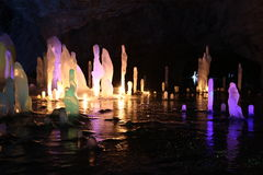 Frozen water Stalagmite in deep marble cave, Russia Royalty Free Stock Photography