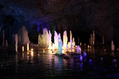 Frozen water Stalagmite in deep marble cave, Russia Stock Image
