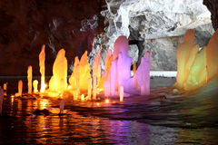 Frozen water Stalagmite in deep marble cave, Russia Stock Photography