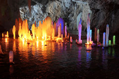 Frozen water Stalagmite in deep marble cave, Russia Stock Images