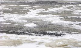 Frozen water surface, winter nature, backgrounds. Frozen water surface. Winter backgrounds and textures of nature stock photography