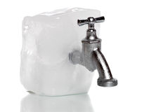 Frozen water-tap on ice rock stock image