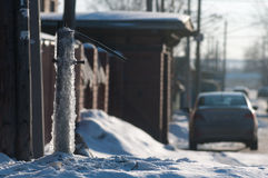 Frozen water-tap on ice rock. Frozen water production crane. Siberian frost Icy street tap for water. street residents can not use water intake Royalty Free Stock Image
