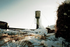 Frozen water tower with big icicles on farm Stock Photos