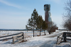 Frozen water tower. Icy water tower, an accident on the water tower, the old rusty tower with frozen water Royalty Free Stock Photography