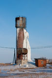 Frozen water tower. Icy water tower, an accident on the water tower, the old rusty tower with frozen water Stock Photo