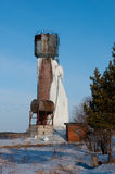 Frozen water tower. Icy water tower, an accident on the water tower, the old rusty tower with frozen water Royalty Free Stock Photo