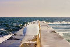 Frozen waterbreaker in the ice. On the northern coast of the Black Sea Stock Photography