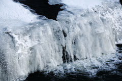 Frozen waterfall. Closeup of partially frozen waterfall in Winter Royalty Free Stock Photos