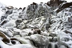 Frozen Waterfall. Waterfall in Kola Peninsula close to Barents Sea (Russia) in wintertime Stock Photos