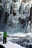 Frozen waterfall. Observed ba an tourist, national park Plitvice in Croatia Stock Photography