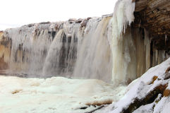 Frozen waterfall. Partially frozen waterfall in Estonia in winter Stock Photography