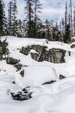 Frozen waterfall Cold winter. Covered by snow Stock Images
