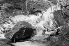 Frozen waterfall - shot with analogue film. Frozen waterfall a cold winter day. Image is taken with a full-frame analogue film camera royalty free stock photo