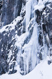Frozen waterfall. Coming from a mountain Stock Photos