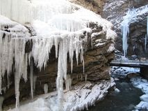 Frozen waterfall with huge beautiful icicles hanging from the rocks stock photos