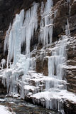 Frozen waterfall. Ice formation from a frozen waterfall above a cave. Photo taken in Tiger Tooth scenic, Sichuan, China Stock Photography