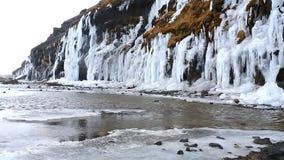 Frozen waterfall in Iceland stock video