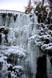 Frozen waterfall with icicles. – seen in the park Wilhelmshöhe at bridge Teufelsbrücke in Kassel, Germany royalty free stock photography