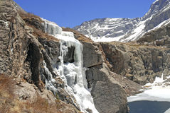 Frozen Waterfall and Icy Lake, Rocky Mountains Stock Photo