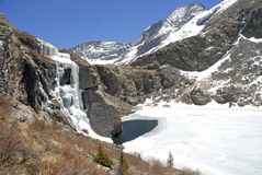 Frozen Waterfall and Icy Lake, Rocky Mountains Stock Image