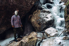Frozen waterfall and man with gas mask Royalty Free Stock Photo