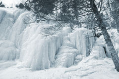 Frozen waterfall on mountain river Stock Photo